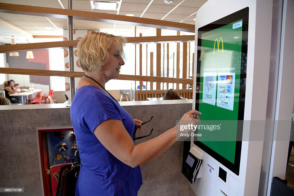 McDonalds customer Jan Ferrell orders a custom meal from the Create Your Taste kiosk at 4000 S. Parker Rd. August 26, 2015. This McDonalds is testing a new concept where diners can customize their burgers and chicken sandwiches with various toppings including BBQ sauce, guacamole, grilled mushrooms, etc. and have their order delivered to your table.