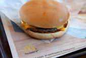 McDonald's double cheesburger sits on a tray at a McDonald's restaurant on July 2 2014 in San Rafael California According to a reader survey...