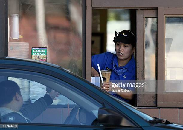 McDonald's drive thru worker hands an order to a customerFebruary 9 2009 in San Francisco California Fast food chain restaurant McDonald's reported a...