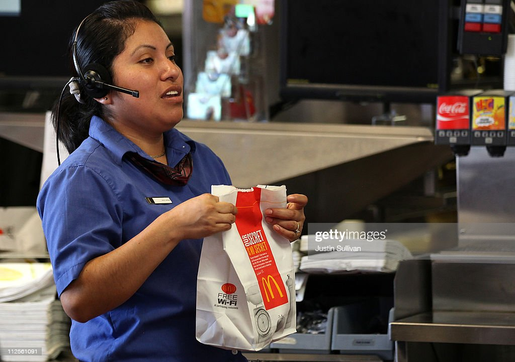McDonald's employee prepares an order during a oneday hiring event at a McDonald's restaurant on April 19 2011 in San Francisco California Hundreds...