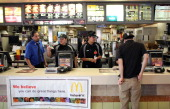 McDonald's employees wait to take orders during a oneday hiring event at a McDonald's restaurant on April 19 2011 in San Francisco California...