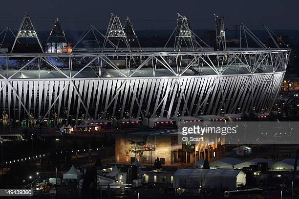 McDonald's fast food restaurant is illuminated in front of the Olympic Stadium during the Opening Ceremony of the Olympic Games on July 27 2012 in...