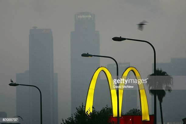 McDonald's fastfood restaurant sign glows above the city skyline on July 24 2008 located in the Figueroa Corridor area of South Los Angeles Los...