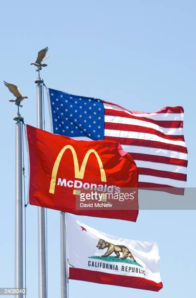 McDonald's flag flies with the American and California flags at the world's oldestoperating McDonald's fast food restaurant on its 50year anniversary...