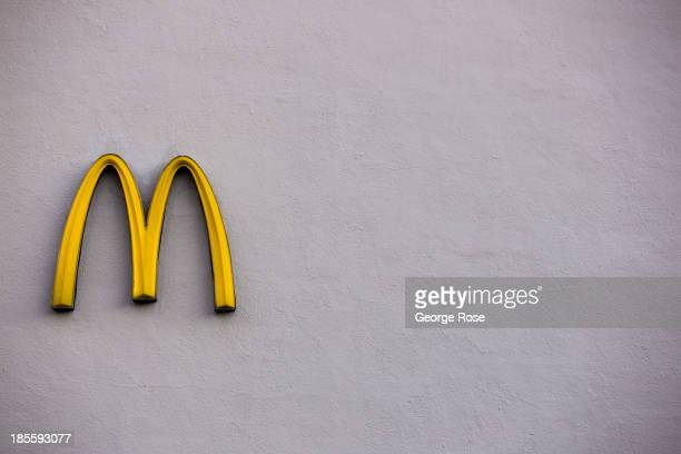 McDonald's golden arches logo hangs on the side of a parking lot wall on September 14 in Reno Nevada Reno located in the northwest corner of Nevada...