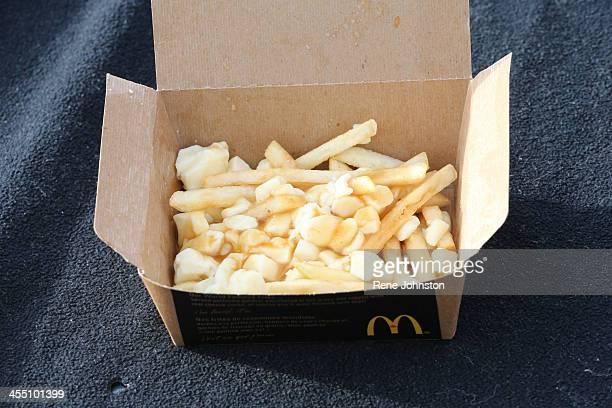McDonalds introduces poutine to their menu Toronto December 10 2013