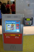 McDonald's is testing new ordering kiosks at a working restaurant at the company's Oak Brook Illinois headquarters