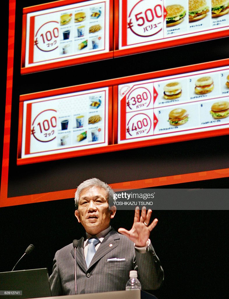 McDonald's Japan new Chairman and CEO <a gi-track='captionPersonalityLinkClicked' href=/galleries/search?phrase=Eiko+Harada&family=editorial&specificpeople=679564 ng-click='$event.stopPropagation()'>Eiko Harada</a>, former Apple Computer Japan President, gestures as he annouces the company's new strategy of one-coin menu at a Tokyo hotel, 31 March 2005. The company will investment 22.7 billion yen (212 million USD) to remodel some 500 their shops this year. AFP PHOTO/Yoshikazu TSUNO