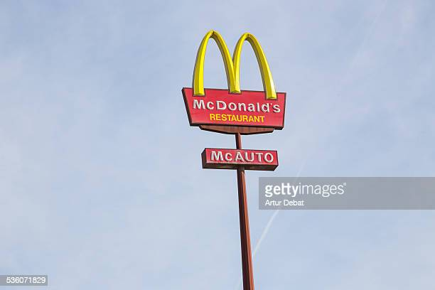 McDonald's red landmark logo with sky