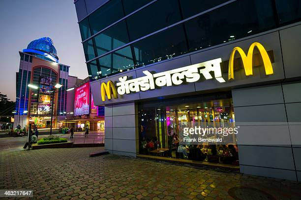 McDonalds restaurant as part of a new and colorful illuminated shopping mall a favored place for middle class Indians to spend time with shopping and...