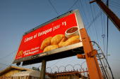 McDonalds restaurant billboard targets a mostlyimmigrant Spanishspeaking population as fastfood restaurants thrive in one of the poorest areas of Los...