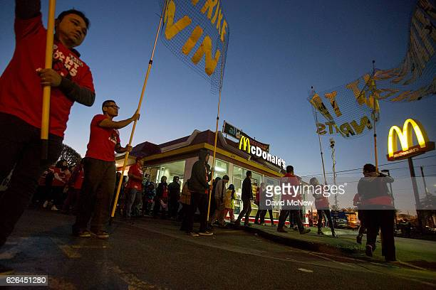 McDonald's restaurant employees rally after walking off the job to demand a $15 per hour wage and union rights during nationwide 'Fight for $15 Day...