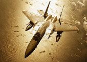 McDonnell Douglas F-15 Eagle in flight over Pacific Ocean (toned B&W)