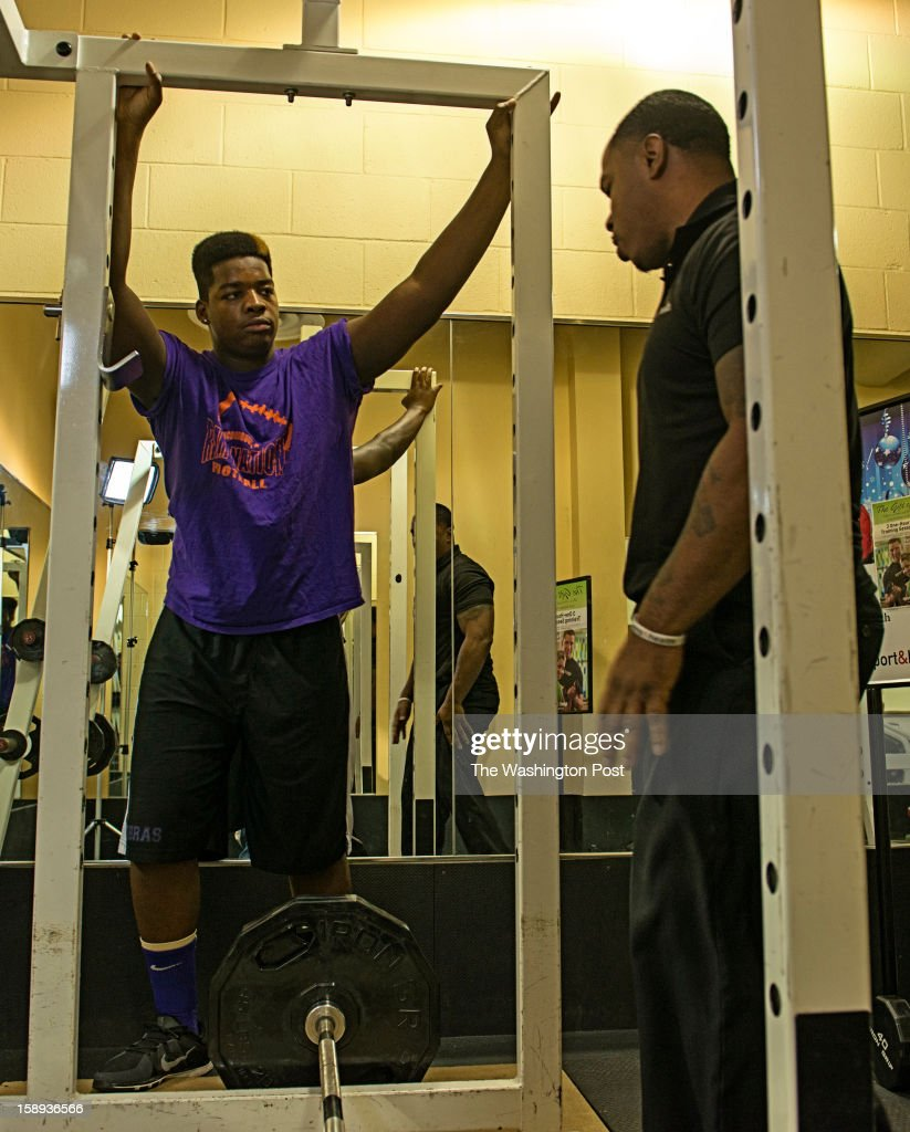 McDonough High School football player Na'Ty Rodgers (center) with trainer Daryl Wills at the Sport & Health Club in Waldorf, Maryland on December 20, 2012. McDonough's Na'Ty Rodgers isn't your average college football recruit. He's taking his time and being patient in making a college decision in an era in which plenty of athletes commit early, only to regret the rushed decision.
