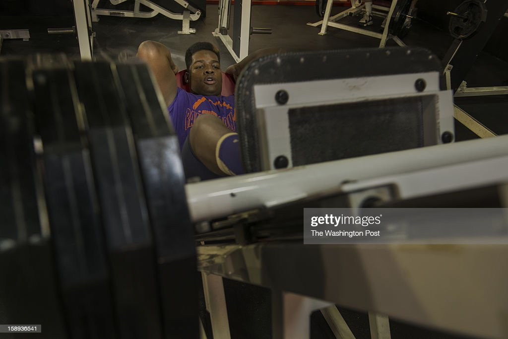 McDonough High School football player Na'Ty Rodgers working out his quadriceps on the leg press machine at the Sport & Health Club in Waldorf, Maryland on December 20, 2012. McDonough's Na'Ty Rodgers isn't your average college football recruit. He's taking his time and being patient in making a college decision in an era in which plenty of athletes commit early, only to regret the rushed decision.