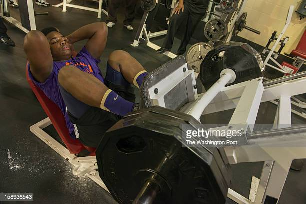 McDonough High School football player Na'Ty Rodgers working out his quadriceps on the leg press machine at the Sport Health Club in Waldorf Maryland...
