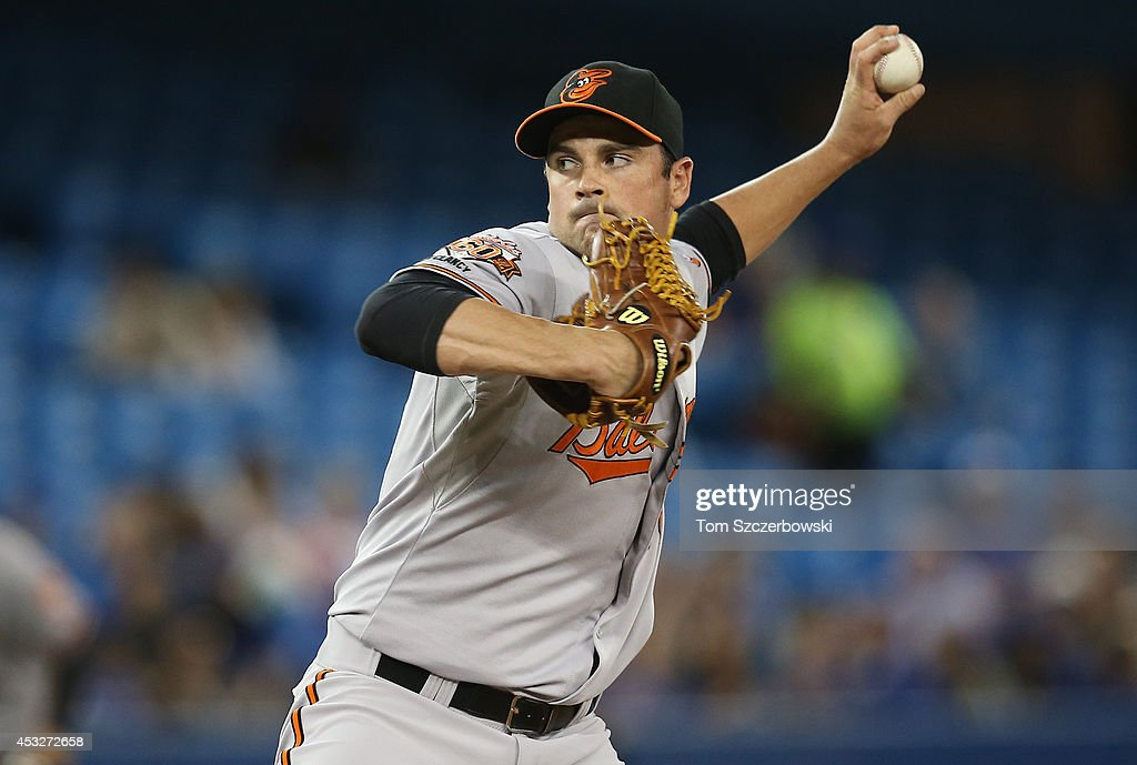 T.J. McFarland #66 of the Baltimore Orioles delivers a pitch in the sixth inning during MLB game action against the Toronto Blue Jays on August 6, 2014 at Rogers Centre in Toronto, Ontario, Canada.