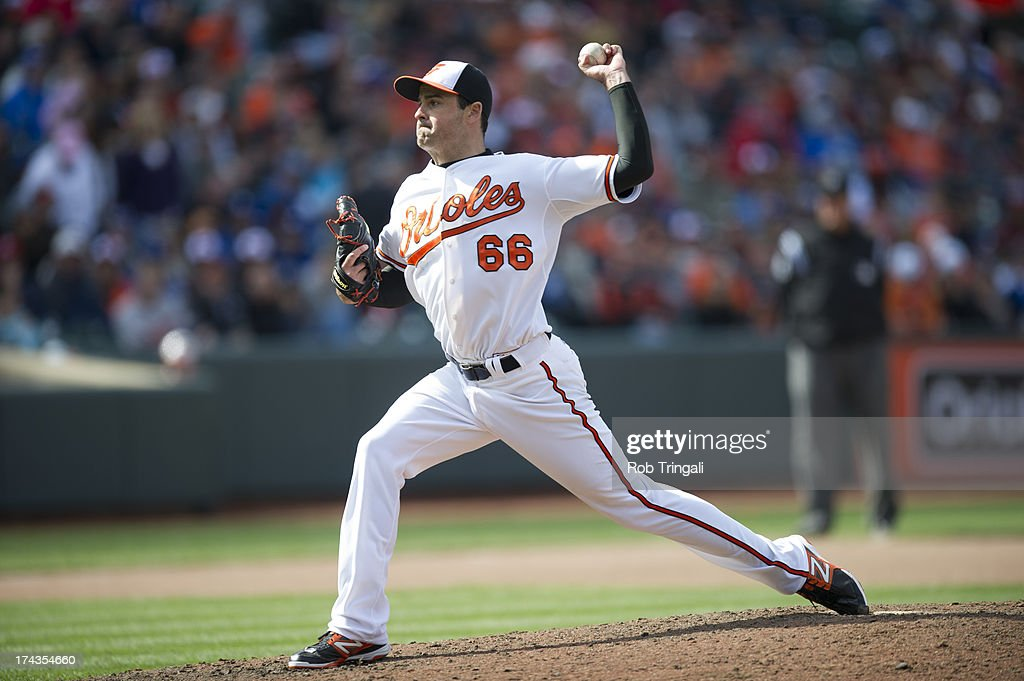 T.J. McFarland #66 of the Baltimore Orioles pitches during the game against the Los Angeles Dodgers at Oriole Park at Camden Yards on April 21, 2013 in Baltimore, Maryland.