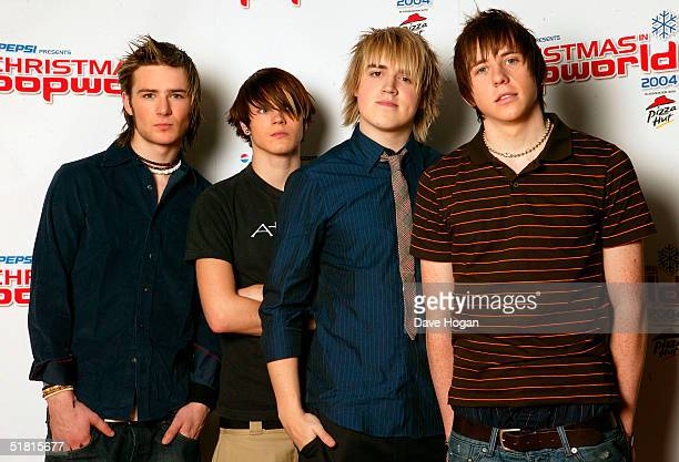 McFly members Harry Judd Dougie Poynter Tom Fletcher and Danny Jones pose in the pressroom ahead of 'Christmas In Popworld' on December 2 2004 at...