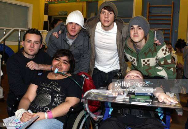 McFly with patients Shannon Sangha and Alex Mcgregor at Yorkhill Children's Hospital in Glasgow shortly before they switched on the Christmas tree...