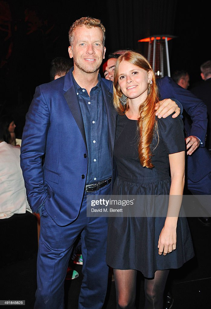 McG (L) and Alix Sidem attend Lionsgate's 'The Hunger Games: Mockingjay Part 1' party at a private villa on May 17, 2014 in Cannes, France.