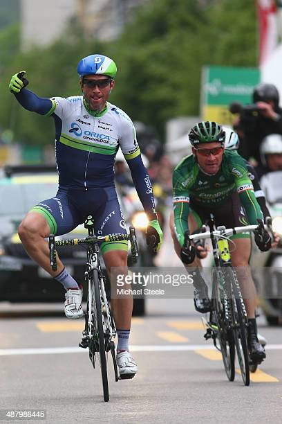 Mchael Albasini of Switzerland and Orica GreenEdge celebrates victory from Thomas Voeckler of France and Team Europcar during stage four of the Tour...