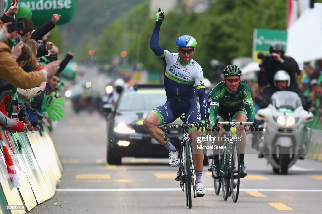 Mchael Albasini of Switzerland and Orica GreenEdge celebrates victory from <a gi-track='captionPersonalityLinkClicked' href=/galleries/search?phrase=Thomas+Voeckler&family=editorial&specificpeople=212948 ng-click='$event.stopPropagation()'>Thomas Voeckler</a> (R) of France and Team Europcar during stage four of the Tour de Romandie from Fribourg to Fribourg on May 3, 2014 in Fribourg, Switzerland.