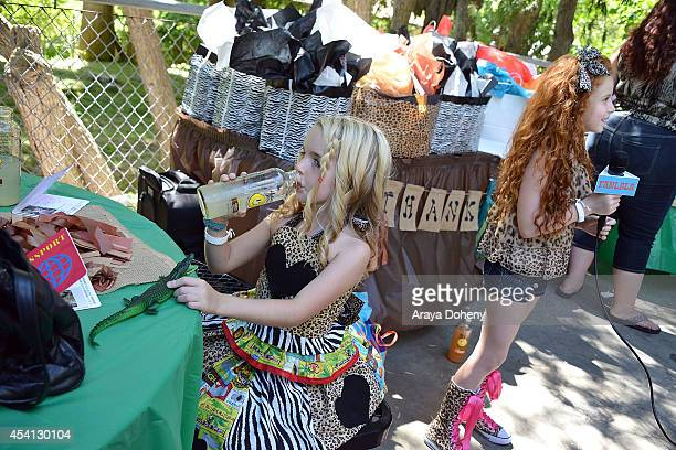 Mckenna Grace and Francesca Capaldi attend August Maturo's 7th birthday celebration at Los Angeles Zoo on August 24 2014 in Los Angeles California
