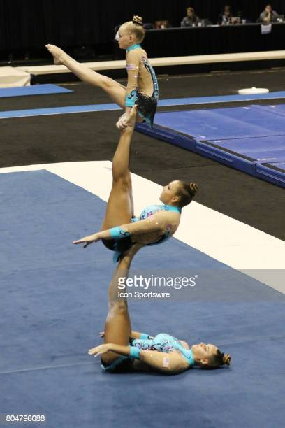 McKenzie Handy Treva Nethery and Megan Nordike perform their acrobatic balance routine during the USA Gymnastics Championships at the BMO Harris...