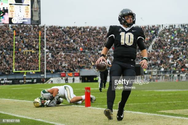 McKenzie Milton of the UCF Knights runs the ball for a touchdown in the first quarter against the South Florida Bulls at Spectrum Stadium on November...