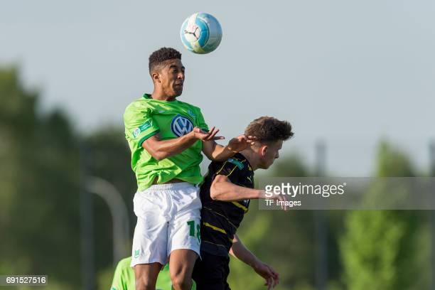 McKinze Gaines II of Wolfsburg and Dzenis Burnic of Dortmund battle for the ball during the U19 German Championship Semi Final second leg match...