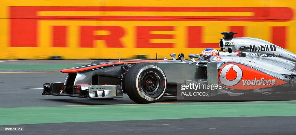 McLaren driver Jenson Button of Britain powers through a corner during the Formula One Australian Grand Prix in Melbourne on March 17, 2013. IMAGE RESTRICTED TO EDITORIAL USE - STRICTLY NO COMMERCIAL USE AFP PHOTO / Paul CROCK