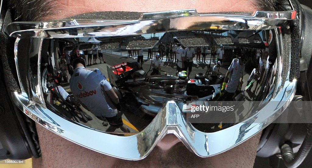 A McLaren Formula One car is reflected on the googles of a mechanic at Interlagos motorsport circuit in Sao Paulo on November 22, 2012 ahead of the Brazilian Grand Prix this weekend.
