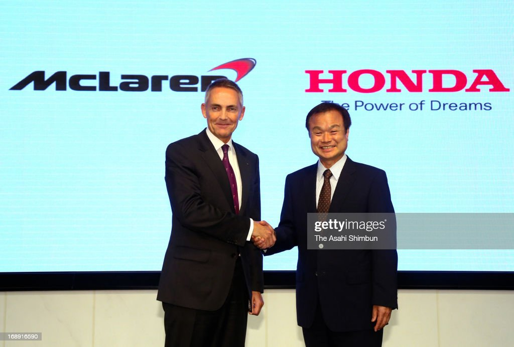 McLaren Group CEO <a gi-track='captionPersonalityLinkClicked' href=/galleries/search?phrase=Martin+Whitmarsh&family=editorial&specificpeople=2374153 ng-click='$event.stopPropagation()'>Martin Whitmarsh</a> (L) and Honda Motor Co President <a gi-track='captionPersonalityLinkClicked' href=/galleries/search?phrase=Takanobu+Ito&family=editorial&specificpeople=5696906 ng-click='$event.stopPropagation()'>Takanobu Ito</a> shake hands during a press conference at Honda's headquarters on May 16, 2013 in Tokyo, Japan. Honda announced to return to Formula One to supply their engine to McLaren from 2015.