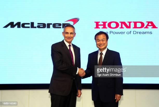 McLaren Group CEO Martin Whitmarsh and Honda Motor Co President Takanobu Ito shake hands during a press conference at Honda's headquarters on May 16...