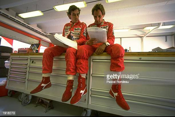 McLaren Honda drivers Ayrton Senna of Brazil and Gerhard Berger of Austria relax after practice for the Hungarian Grand Prix at the Hungaroring...