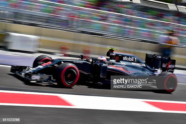 McLaren Honda F1 Team's British driver Jenson Button steers his car at the Baku City Circuit on June 18 2016 in Baku during the third practice...