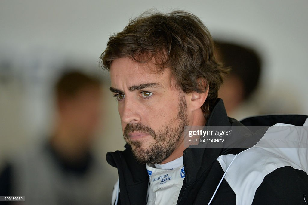 McLaren Honda F1 Team's Spanish driver Fernando Alonso waits in the pits during the third practice session of the Formula One Russian Grand Prix at the Sochi Autodrom circuit on April 30, 2016. / AFP / YURI