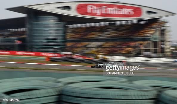 McLaren Honda's British driver Jenson Button steers his ...