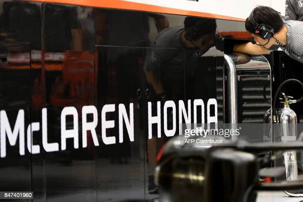 McLaren Honda's crew member works in the teamgarage during the second practice session of the Formula One Singapore Grand Prix night race on...
