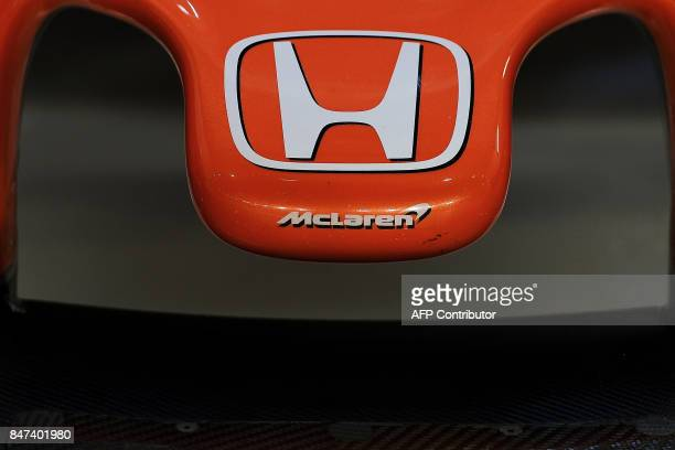 McLaren Honda's logo is seen on Spanish driver Fernando Alonso's car during the second practice session of the Formula One Singapore Grand Prix night...