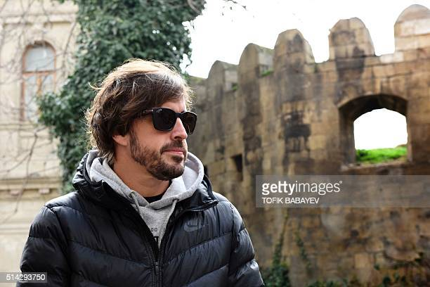 McLaren Honda's Spanish driver Fernando Alonso looks on as he walks in downtown Baku on March 8 ahead of a Formula One Grand Prix to be held in the...