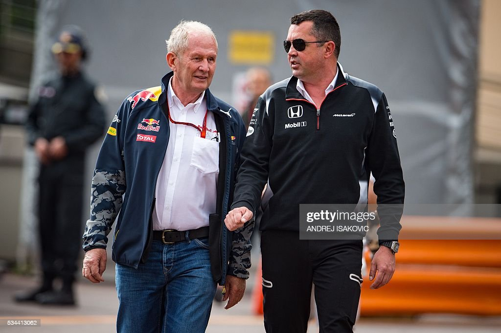 McLaren Honda's team principal Eric Boullier (R) and Red Bull Racing Formula One team chief technical officer Adrian Newey (L) talk during the first practice session at the Monaco street circuit, on May 26, 2016 in Monaco, three days ahead of the Monaco Formula 1 Grand Prix. / AFP / ANDREJ