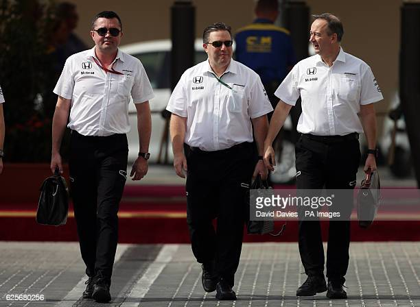 McLaren management Eric Boullier Zak Brown and Jonathan Neale during practice at Yas Marina Circuit Abu Dhabi