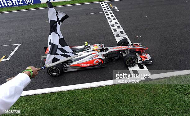 McLaren Mercedes' British driver Lewis Hamilton crosses the finish line of the SpaFrancorchamps circuit on August 29 2010 in Spa after the Formula...