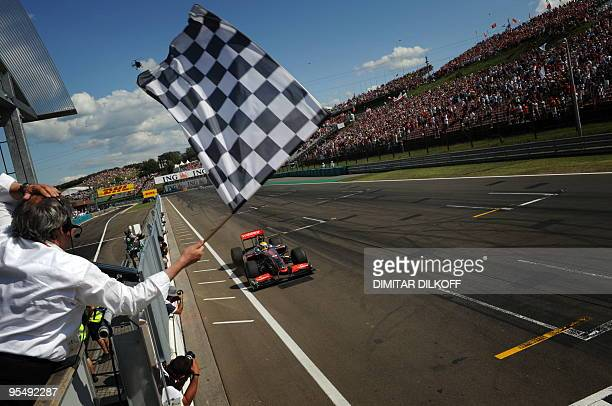 McLaren Mercedes' British driver Lewis Hamilton crosses the finish line of the Hungaroring racetrack on July 26 2009 in Budapest after the Hungarian...