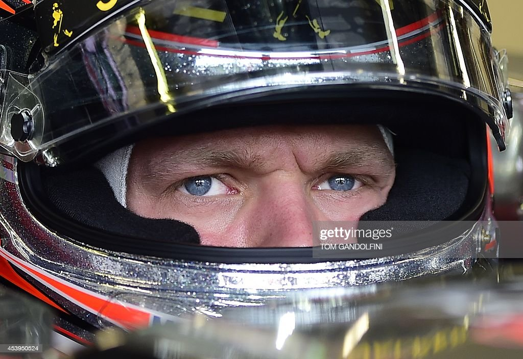 McLaren Mercedes' Danish driver Kevin Magnussen sits in the pits during the first practice session at the Spa-Francorchamps circuit in Spa on August 22, 2014 ahead of the Belgium Formula One Grand Prix.