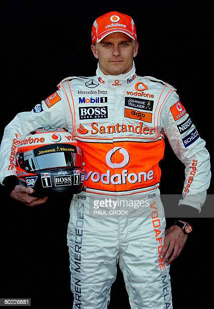 McLaren Mercedes driver Heikki Kovalainen of Finland poses with his helmet during the leadup to the Australian Formula One Grand Prix Melbourne on...