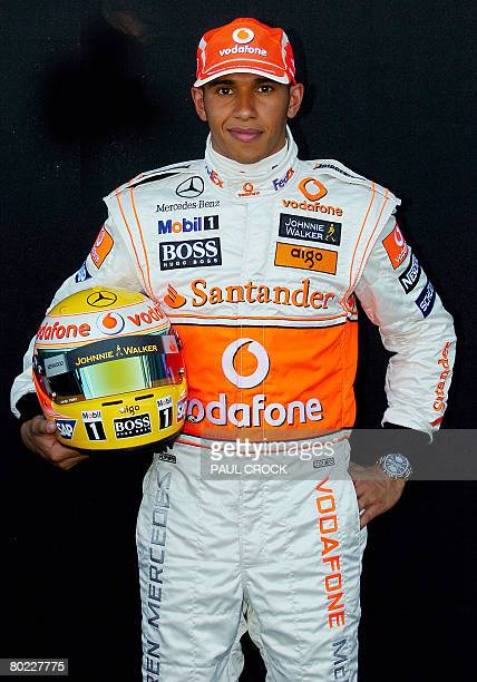 McLaren Mercedes driver Lewis Hamiltion of Great Britain poses with his helmet during the leadup to the Australian Formula One Grand Prix Melbourne...