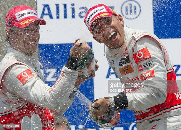 McLaren Mercedes driver Lewis Hamilton of Britain and teammate McLaren Mercedes driver Jenson Button of Britain celebrate with champagne after...